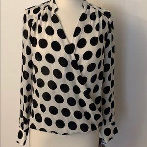 INC large white and black polka dot blouse.